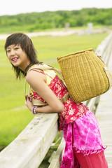 Portrait of woman carrying basket