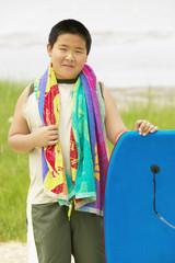 Portrait of boy with body board