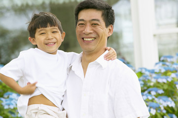 Portrait of father and son laughing