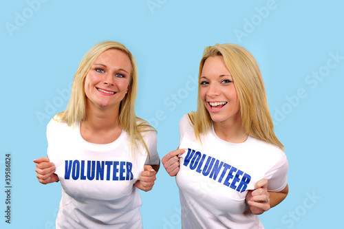 two happy volunteer girls