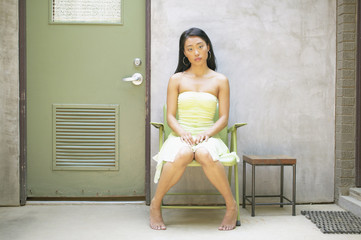 Woman sitting in chair near door