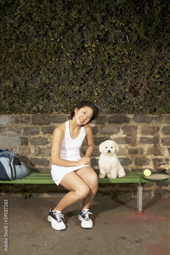 Female tennis player with dog