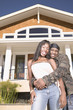 Portrait of couple in front of house