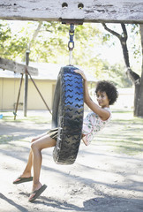 Portrait of woman on tire swing