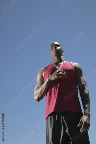 Low angle view of man with metal