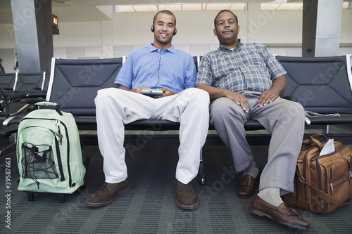 Portrait of two men at airport
