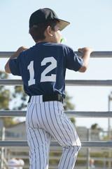 Rear view of boy watching baseball game