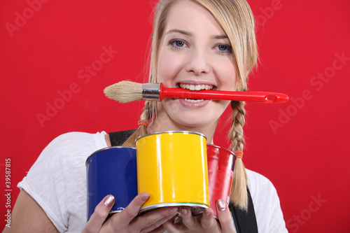 portrait of female painter holding brush between her teeth