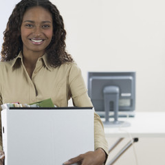 Portrait of businesswoman holding box