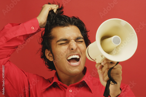 Man yelling through bull horn