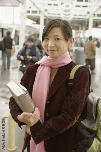 Portrait of teenage girl with books