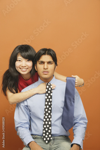 Portrait of couple selecting tie