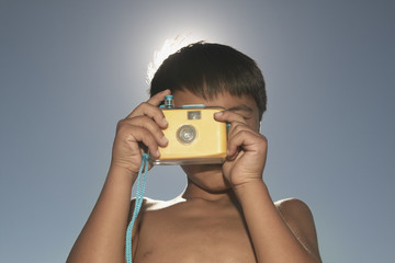 Boy talking photograph with camera