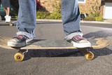 Low section of teenagers on skateboards