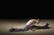 Man doing splits on roller skates