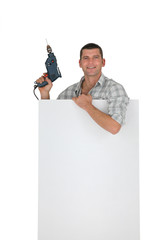 Handyman behind white board