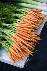 Fresh organic carrots at market stall