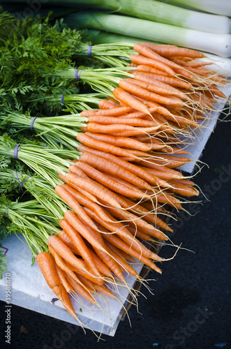 Fresh organic carrots at market stall