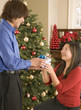 Man giving woman Christmas gift