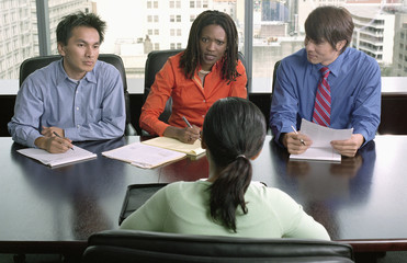 High angle view of four business executives in a meeting