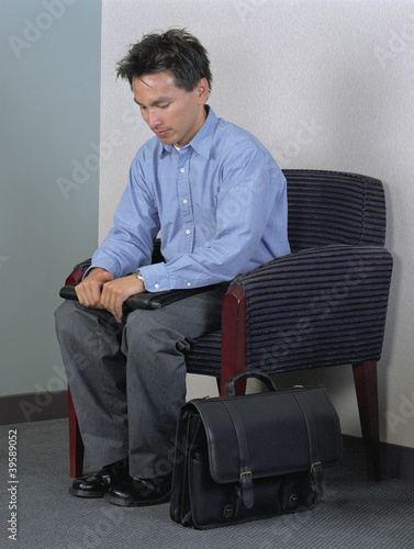 Stressed businessman in chair