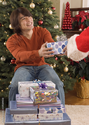 Man giving gift to Santa