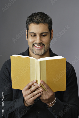 Close up of man reading book