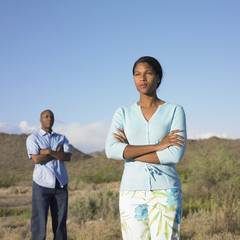 Couple in a fight standing in field