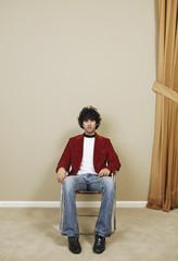 Portrait of man sitting in chair
