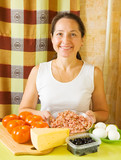 woman with ingredients for stuffed tomato