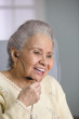 Elderly woman using a headset
