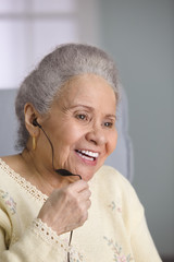 Elderly woman using a headset