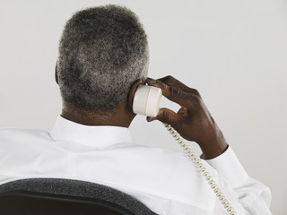 Rear view of businessman talking on phone