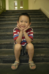 Young boy smiling on staircase