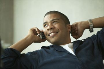 Young man talking on cell phone