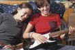 Teenage girls playing the electric guitar