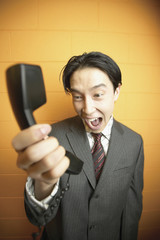 Businessman shouting at phone