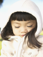 Closeup of young girl in parka