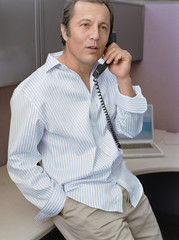 Businessman talking on the phone at desk