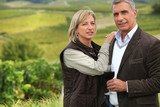 Couple drinking a glass of wine in a vineyard