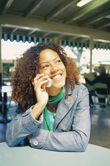 Portrait of young woman using cell phone