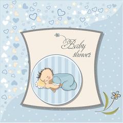 little baby boy sleep with his teddy bear toy