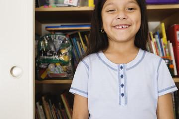 Girl standing in front of bookshelves