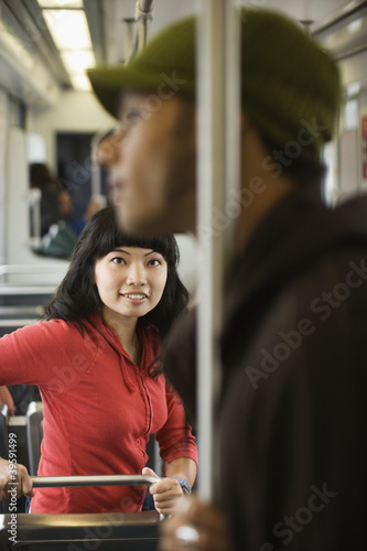 Young woman looking at young man