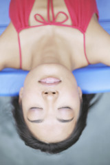 Overhead view of a relaxed young woman