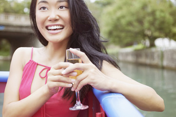Woman on a boat holding a glass of wine