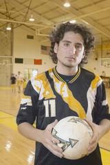 Teenage boy holding soccer ball