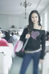 Teenage girl carrying shoulder bag