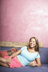 Young woman relaxing on couch