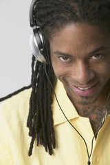 African American man wearing headphones and smiling